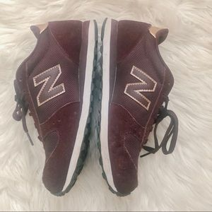 Great used condition New Balance 311's w/rose gold